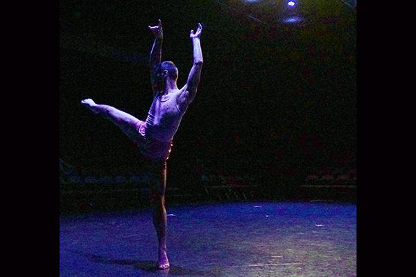 Dancer performing on Barnett Theatre stage